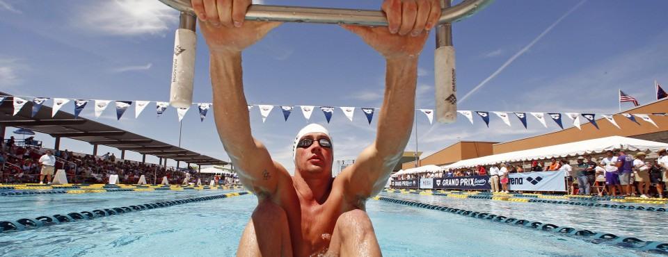 Apr 25, 2014; Mesa, AZ, USA; Ryan Lochte in the starting block before the 200m backstroke prelims during the Arena Grand Prix at Skyline Aquatic Center. Mandatory Credit: Rob Schumacher-USA TODAY Sports