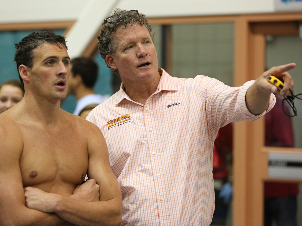 Jul 13, 2014; Athens, GA, USA; Swimming coach David Marsh talks with Ryan Lochte during the Sunday finals of the Bulldog Grand Slam at Gabrielsen Natatorium. Mandatory Credit: Kevin Liles-USA TODAY Sports