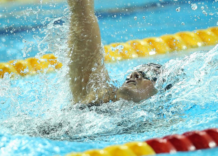 (140818) -- NANJING, Aug 18, 2014 (Xinhua) -- Clara Smiddy(C) of United States of American competes during the Women's 100m Backstroke match at Nanjing 2014 Youth Olympic Games in Nanjing, capital of east China's Jiangsu Province, on Aug. 18, 2014.Clara Smiddy of United States of American won the gold medal.(Xinhua/Fei Maohua)(hhx)