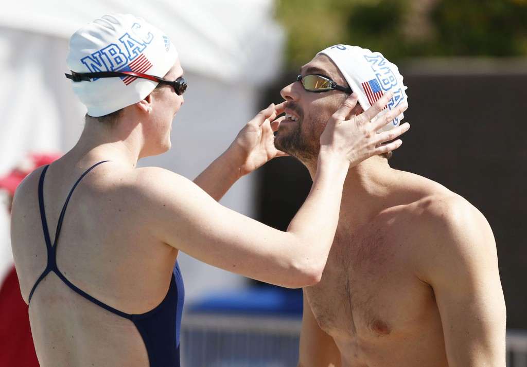 Apr 15, 2015; Mesa, AZ, USA; North Baltimore Aquatic Club teammates Allison Schmitt and Michael Phelps check their goggles during practice session at the Arena Pro Swim Series at Skyline Aquatic Center. Mandatory Credit: Rob Schumacher/Arizona Republic via USA TODAY Sports
