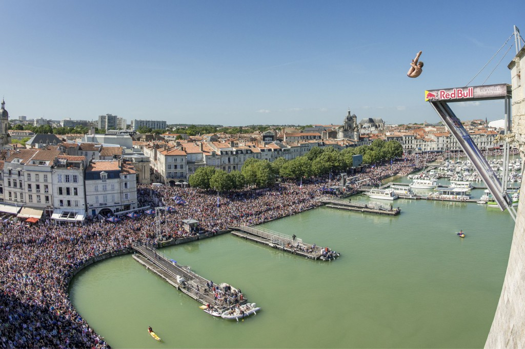 Gary Hunt of the UK dives from the 27.5 metres platform on the Saint Nicolas Tower during the second stop of the Red Bull Cliff Diving World Series, La Rochelle, France on May 17 2015.