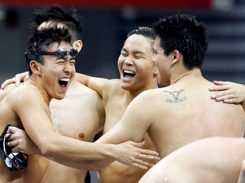 28th SEA Games Singapore 2015 - OCBC Aquatic Centre, Singapore - 7/6/15 Swimming - Men's 4x200m Freestyle Relay - Final - Singapore's Quah Zheng Wen (L), Pang Sheng Jun (C) and Joseph Schooling celebrate winning the relay SEAGAMES28 TEAMSINGAPORE Mandatory Credit: Singapore SEA Games Organising Committee / Action Images via Reuters