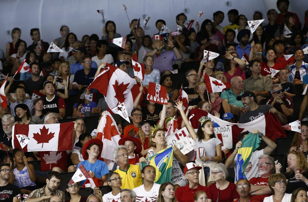 Jul 16, 2015; Toronto, Ontario, CAN; Fans of Canada cheer during the medals ceremony for the men's swimming 4x200m freestyle relay final during the 2015 Pan Am Games at Pan Am Aquatics UTS Centre and Field House. Mandatory Credit: Rob Schumacher-USA TODAY Sports