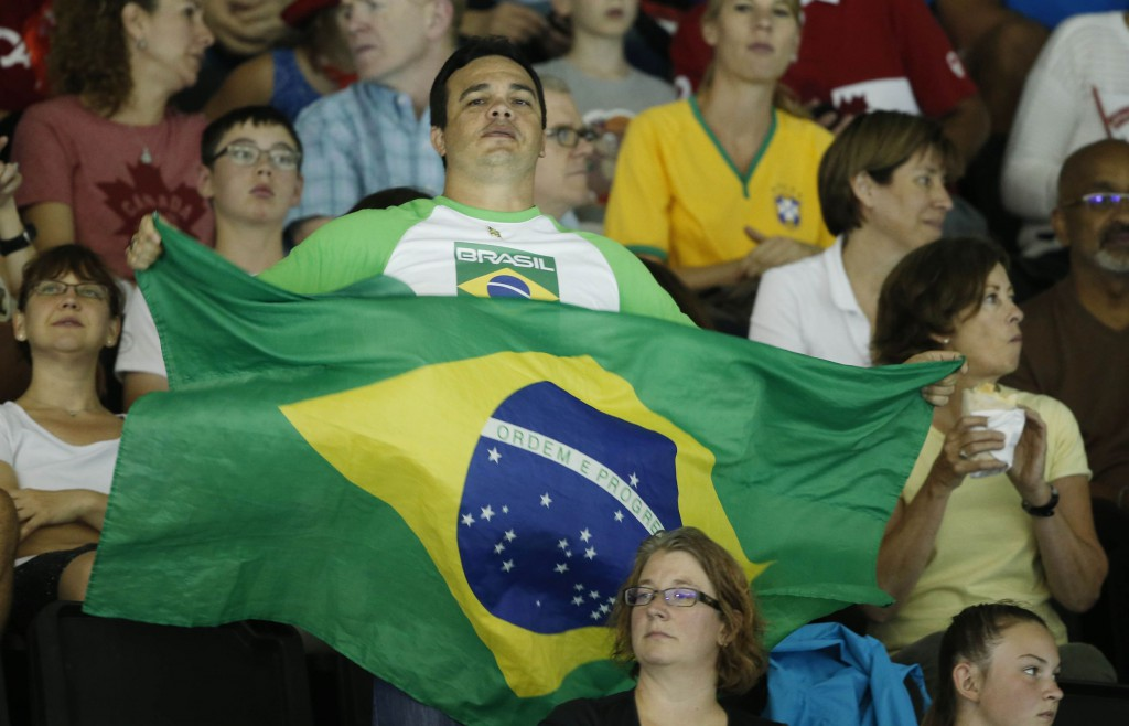 Jul 17, 2015; Toronto, Ontario, CAN; A fan of Brazil waves a flag during the medal ceremony for the women's swimming 400m individual medley final the 2015 Pan Am Games at Pan Am Aquatics UTS Centre and Field House. Mandatory Credit: Erich Schlegel-USA TODAY Sports