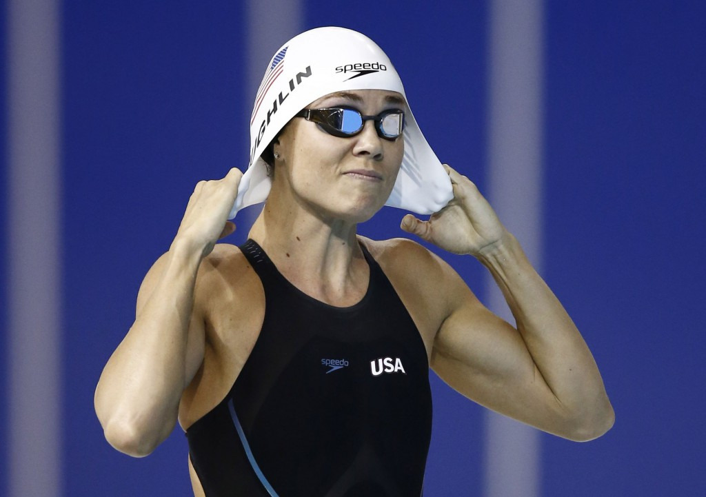 Jul 14, 2015; Toronto, Ontario, CAN; Natalie Coughlin of the United States adjusts her swim cap before the women's 100m freestyle swimming preliminaries during the 2015 Pan Am Games at Pan Am Aquatics UTS Centre and Field House. Mandatory Credit: Rob Schumacher-USA TODAY Sports
