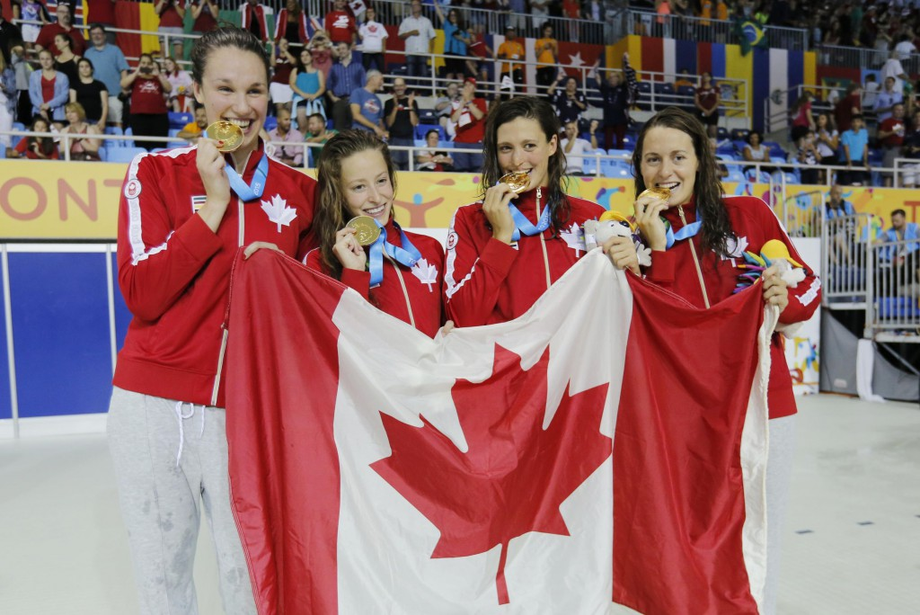 Jul 14, 2015; Toronto, Ontario, CAN; Canada team members Sandrine Mainville , Katerine Savard , Michelle Williams and Chantal Van Landeghem of Canada celebrate after winning the women's 4x100m freestyle swimming relay final during the 2015 Pan Am Games at Pan Am Aquatics UTS Centre and Field House. Mandatory Credit: Erich Schlegel-USA TODAY Sports