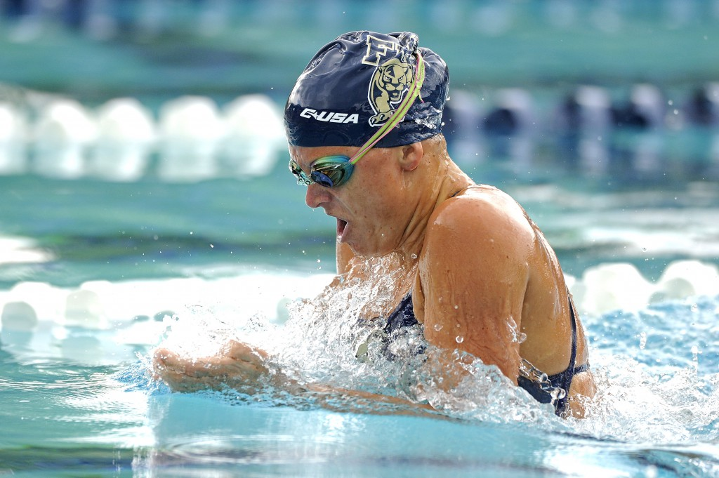 17 October 2015: FIU's Chase Harris competes in the 200 yard breaststroke as the FIU Golden Panthers defeated the University of Miami Hurricanes on day 2 of the FIU Dual-A-Palooka Swim Meet at the Gulliver Preparatory Aquatic Center in Miami, Florida.