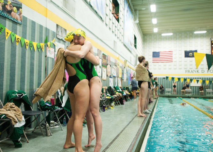 uvm-vermont-hug-teammate-love-support