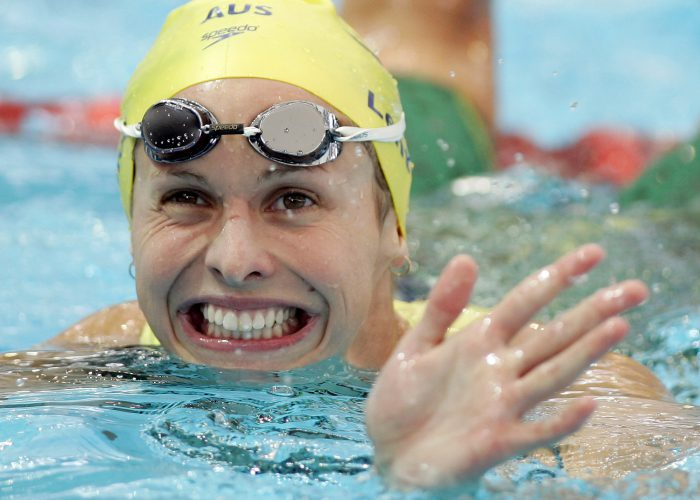 Libby Lenton Trickett smiles after competing in the heats of the women's 100m freestyle at the Commonwealth Games in Melbourne March 17, 2006. REUTERS/Tim Wimborne - GM1DSEGRRAAA