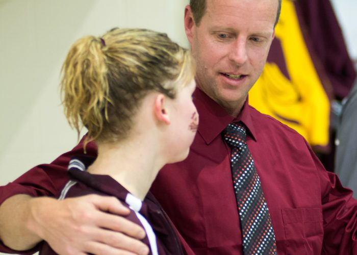 coach comforts swimmer