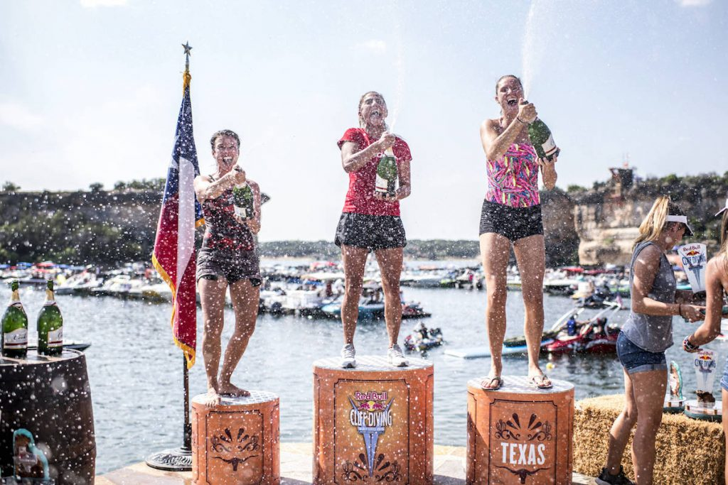 Anna Bader (L) of Germany, Adriana Jimenez (C) of Mexico and Jessica Macaulay of Australia celebrate on the podium during the final competition day of the first stop at the Red Bull Cliff Diving World Series in Possum Kingdom Lake, Texas, USA on June 2, 2018. // Dean Treml/Red Bull Content Pool // AP-1VUWZH9YS2111 // Usage for editorial use only // Please go to www.redbullcontentpool.com for further information. //