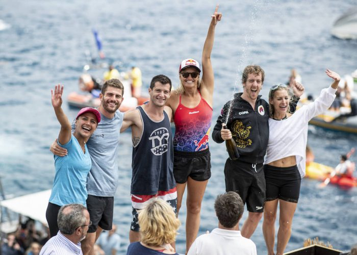 (L-R) Adriana Jimenez of Mexico, David Colturi and Steven LoBue of the USA, Rhiannan Iffland of Australia, Gary Hunt of the UK and Lysanne Richard of Canada celebrate on the podium at Islet Vila Franca do Campo during the final competition day of the third stop at the Red Bull Cliff Diving World Series in Azores, Portugal on July 14, 2018. // Dean Treml/Red Bull Content Pool // AP-1W9C2PQJ52111 // Usage for editorial use only // Please go to www.redbullcontentpool.com for further information. //